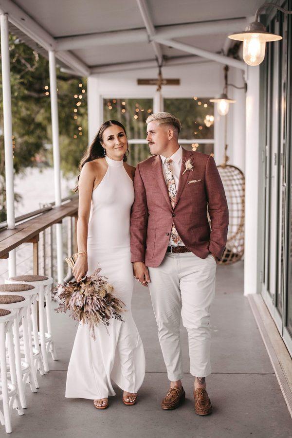 bride and groom on ancora waterside deck