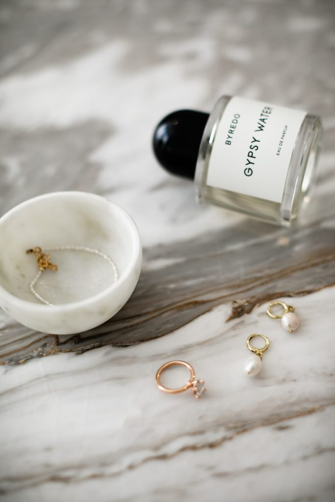 Jewellery and perfume on marble