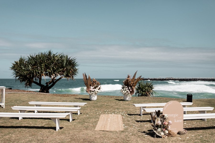 A beach side wedding ceremony set up
