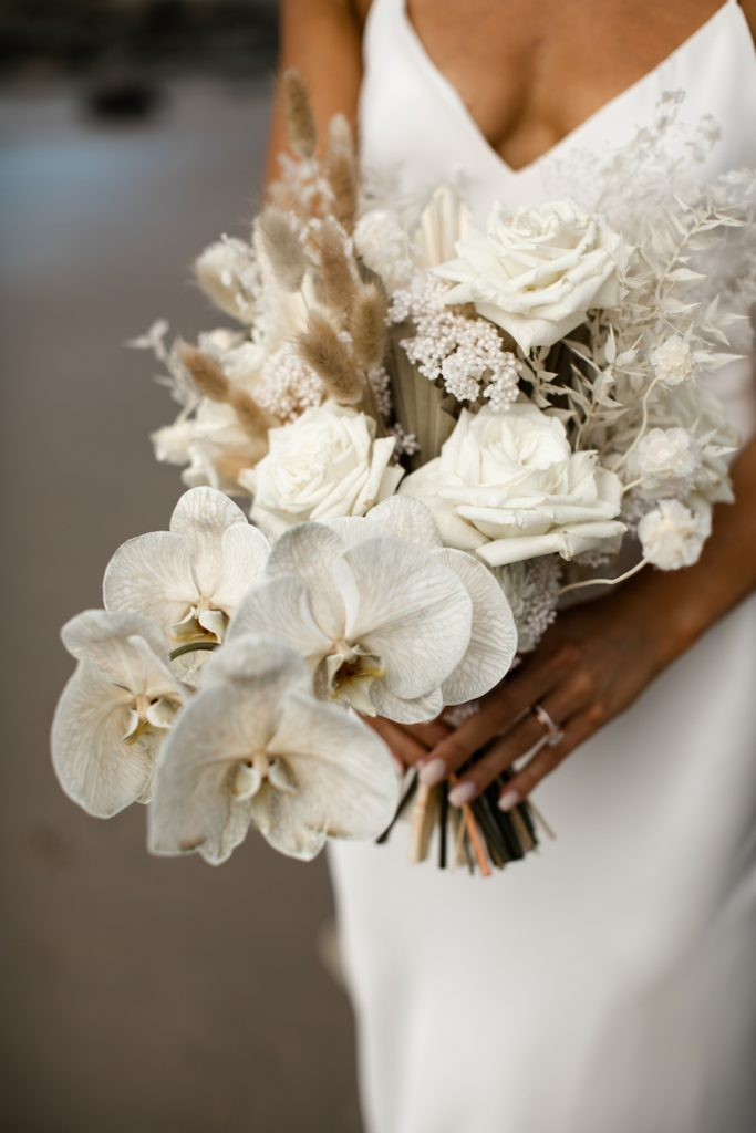 A white bouquet featuring fresh and dried florals