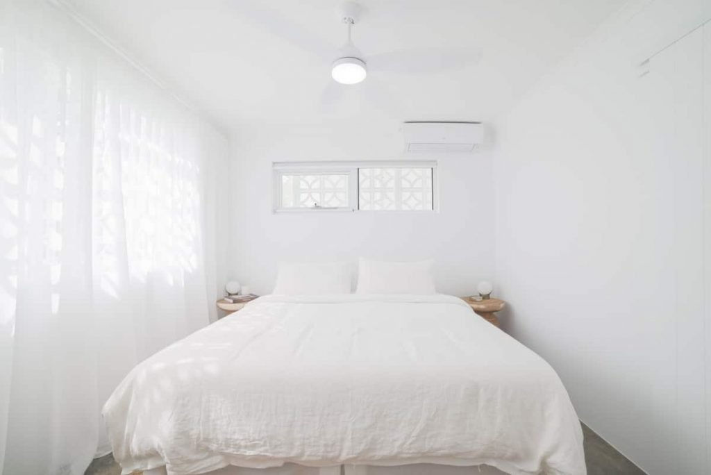 White master bedroom at Palm beach accommodation