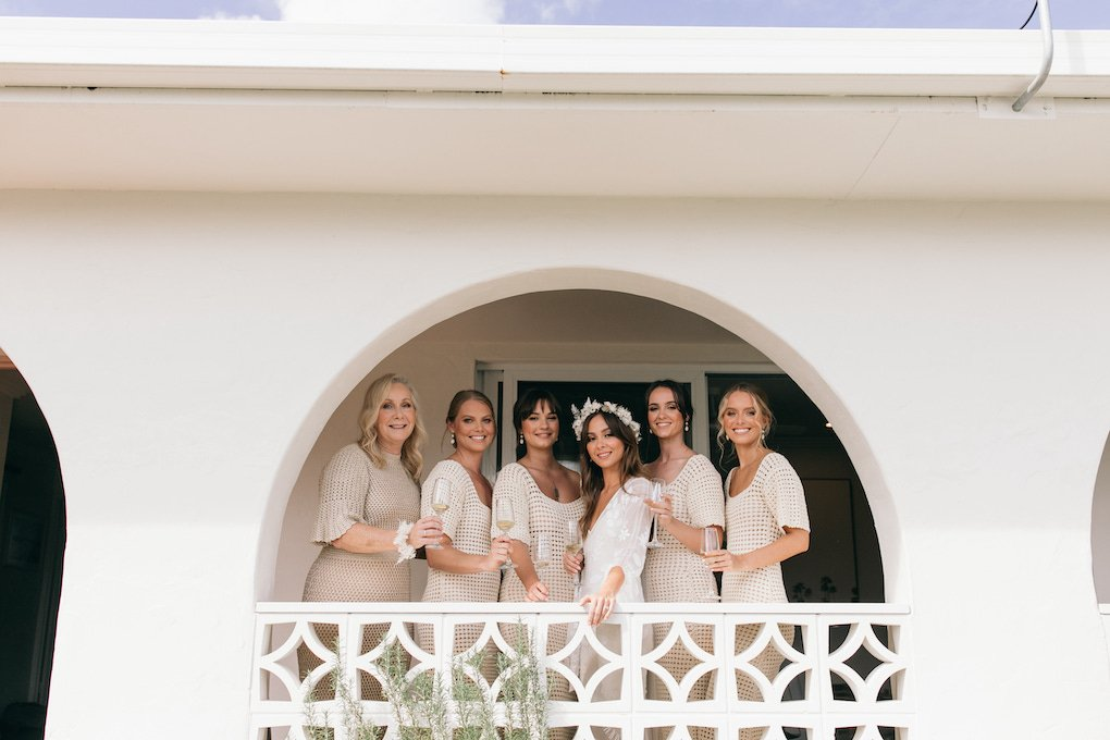 Bridesmaids in white breeze block archway at Tweed Heads accommodation