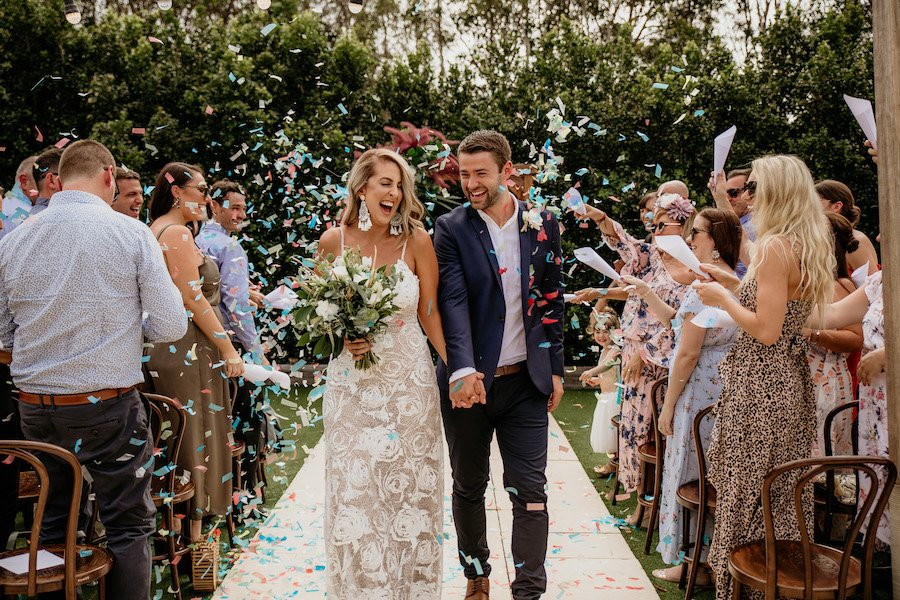 Bride and groom with confetti celebrating