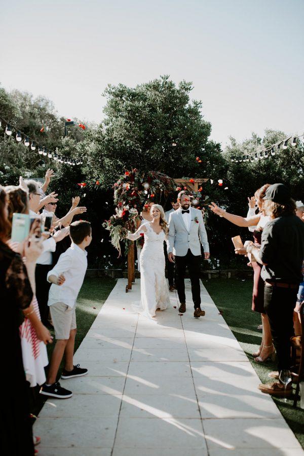 bride and groom just married in garden ceremony