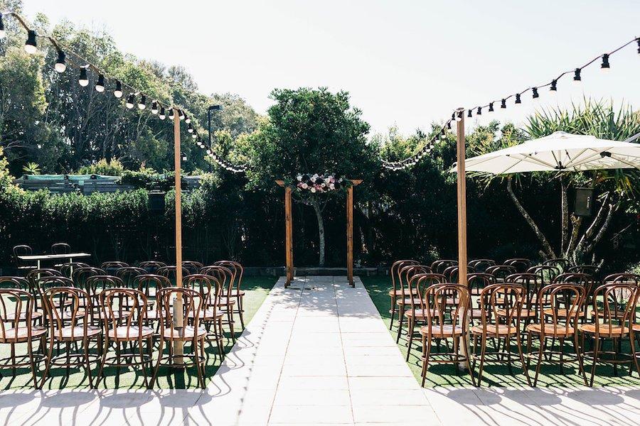 osteria weddings private garden ceremony setup