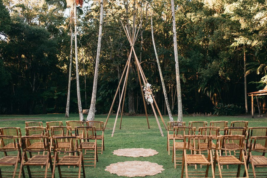wedding ceremony open lawn with tipi arbour