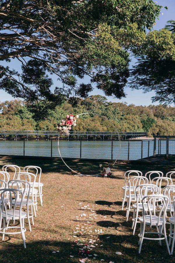 A waterside garden ceremony set up